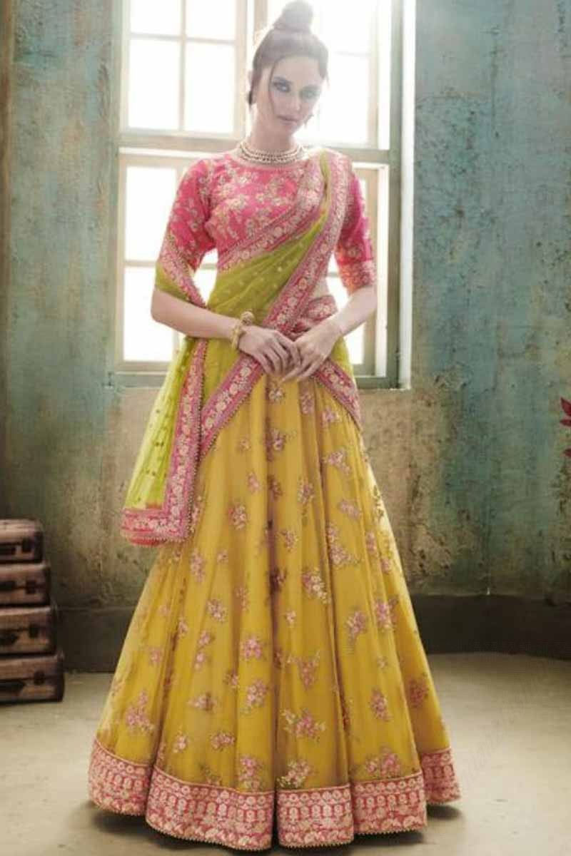 64a2e7770d Thumbnail Image of Pink And Yellow Raw Silk Lehenga With Net Choli Display  Gallery Item 1 ...